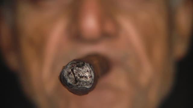 ECU Man smoking cigar / San Luis, Pinar del Rio, Cuba