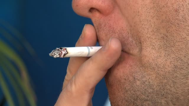 Man Smoking Cigarette on June 19 2012 in San Diegoe California