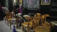 Man smoking Narghile at a Coffee shop at Cairo street market