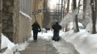 WS Man snowblowing sidewalk during winter / New York City, New York, USA