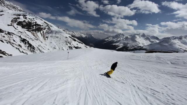 Man snowboarding in ski resort