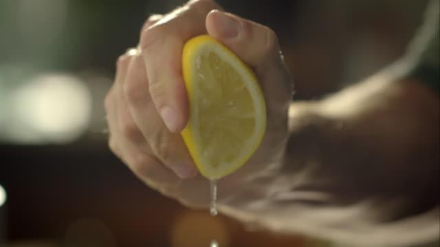 Man squeezing lemon