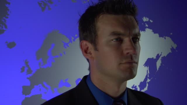 CU, PAN, Man standing against blue World map