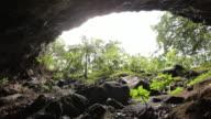 MS ZI Man standing at entrance of Waikapalae Cave / Haena, Kauai, Hawaii, USA