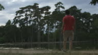 Man standing in front a lake