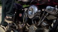 LA, CU, TU, ZI, Man starting motorcycle and turning accelerator, Jacksonville, Florida, USA