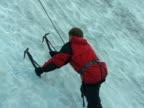 Man Starts Climbing Glacier Ice Wall