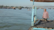 WS Man Steering His Boat in Water / Vietnam
