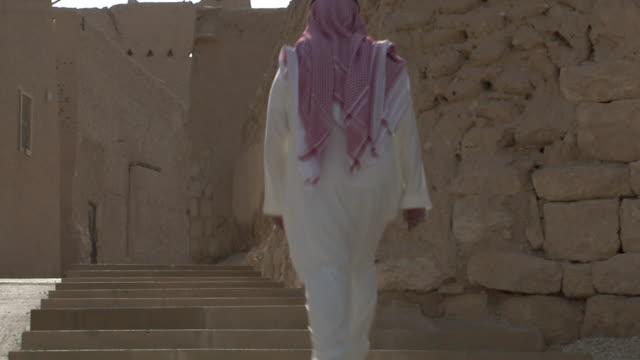 WS Man stepping upstairs / Riyadh City, Riyadh, Saudi Arabia