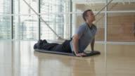 WS Man stretching downward dog pose yoga / Vancouver, British Columbia, Canada
