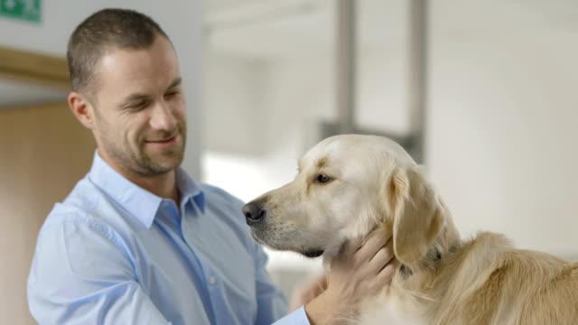 Man Stroking His Dog