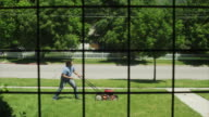 WS Man struggling with lawnmower / Provo, Utah, USA