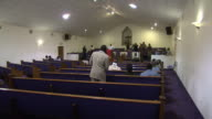 WS A man swaying to the singing church choir /Mississippi United States