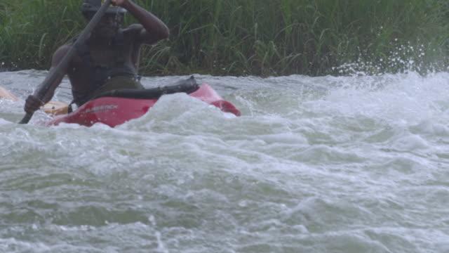 MS PAN SLO MO Man swimming in waterfalls / Jinja, Uganda