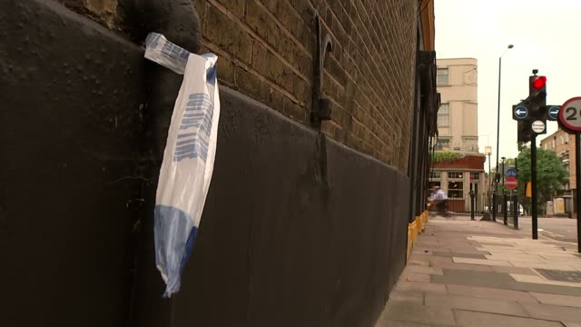 Man taken to hospital after acid attack T14071732 / TX Hackney Empty water bottle on road Piece of police tape cordon attached to wall Plastic bottle...