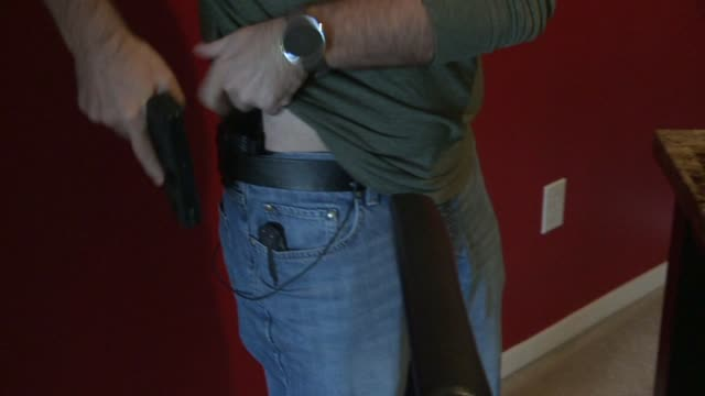 WXIN Man Takes Handgun And Tucks in Holster Under Shirt on December 4 2015