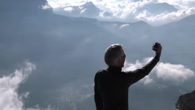 Man takes selfie on mountain top