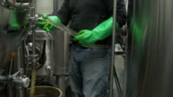 Man taking a sample from a beer fermenter