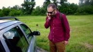 Man talking mobile phone and ask for help for the car