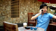 Man Talking on Phone Outdoors.