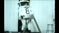 WGN Man tests flexibility of a space and diving suit in Chicago in October 1961