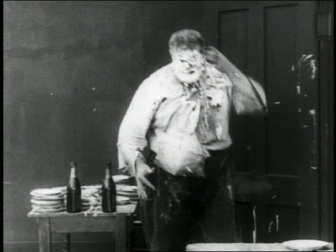 B/W 1916 man throwing pie at man who ducks / hits Shakesperean actor