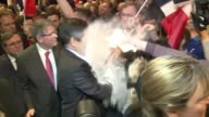 A man throws flour on conservative French presidential candidate Francois Fillon as he arrives for a campaign rally in Strasbourg