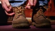 Man ties work boots