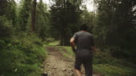 Man trail running in a forest area