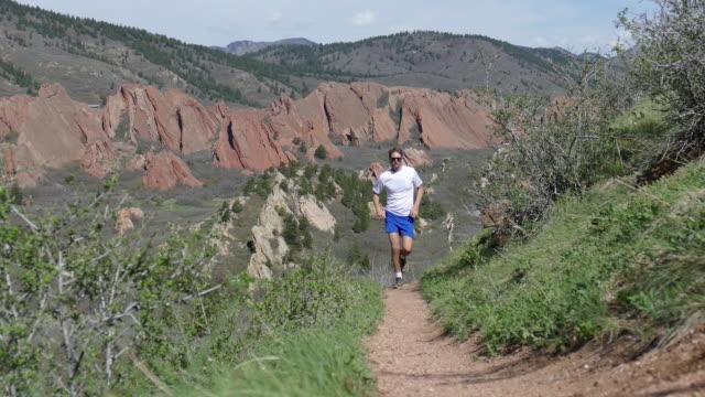Man trail runs through Roxbrough State Park in Colorado mountains