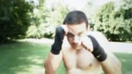 HD SLOW MOTION: Man Training Muay Thai Outdoors