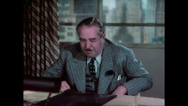 Man (Walter Connolly) tries to stay calm as his anger builds into threats against another man (Fredric March)