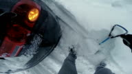 POV Man trying to dig car out of the snow