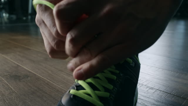 Man tying shoelaces