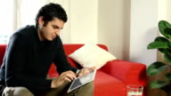 Man typing on touch screen tablet pc keyboard