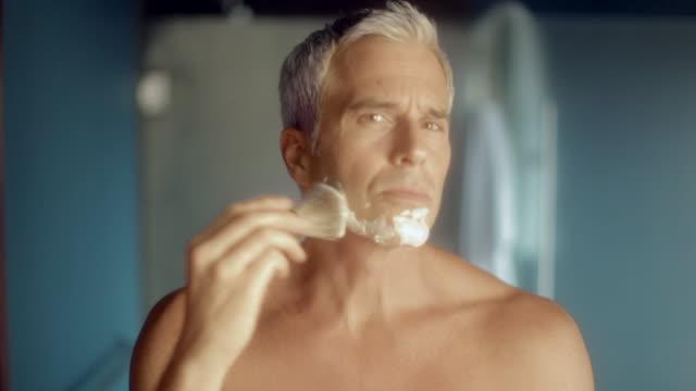 MS Man use shaving cream on face / Seattle, WA, United States