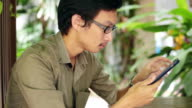 Man Use Tablet at cafe
