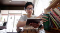 Man use Tablet in coffee shop