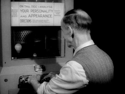 A man uses a personality testing machine in the amusement arcade on Brighton's Palace Pier