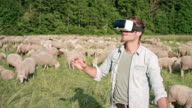 man uses his hi-end VR-headset (virtual reality) outside in the nature
