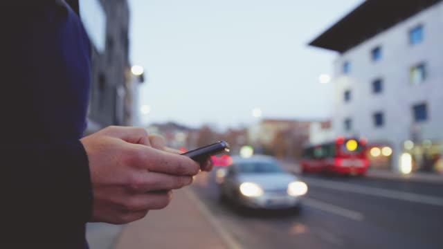 MS Man using a smartphone on sidewalk
