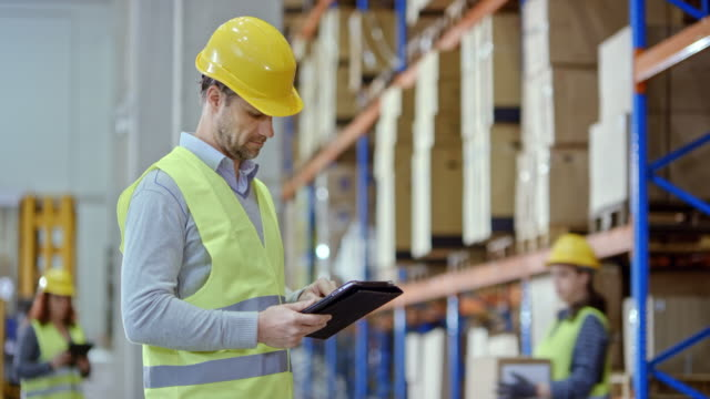 Man using a tablet in the warehouse