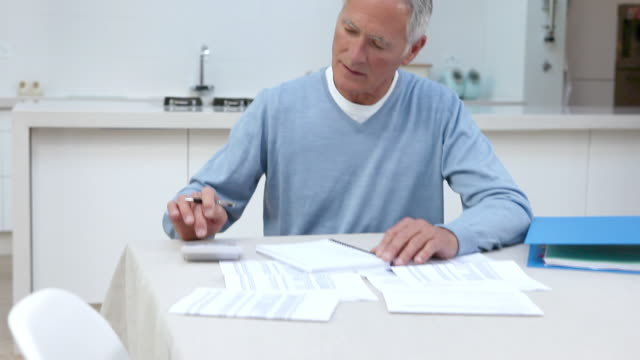 Man using calculator to do home finances