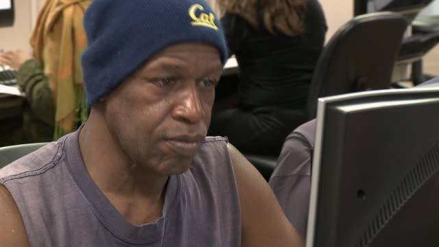 Man using computer in job center/ Antioch California USA/ AUDIO