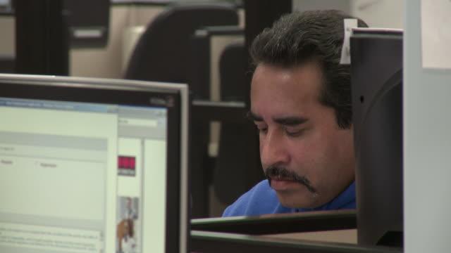 Man using computer in job center/ Antioch Caliornia USA/ AUDIO