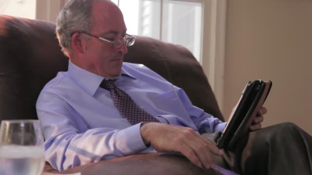 MS Man using digital tablet in living room / Lorton, Virginia, United States