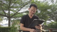 4K DOLLY : Man using digital tablet in the garden