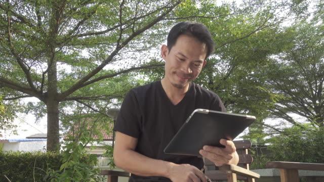 4K DOLLY : Man using digital tablet in the garden