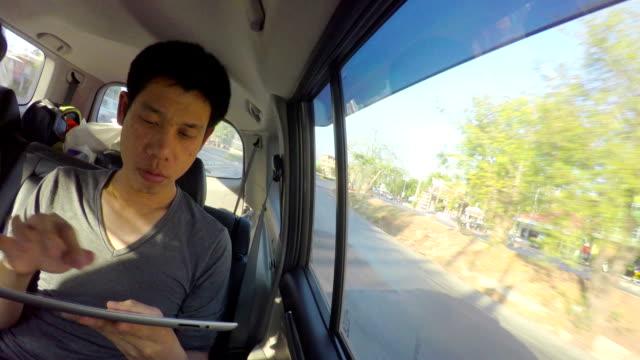 Man using mobile phone inside the car