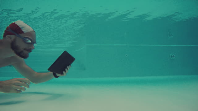 Man using mobile phone underwater